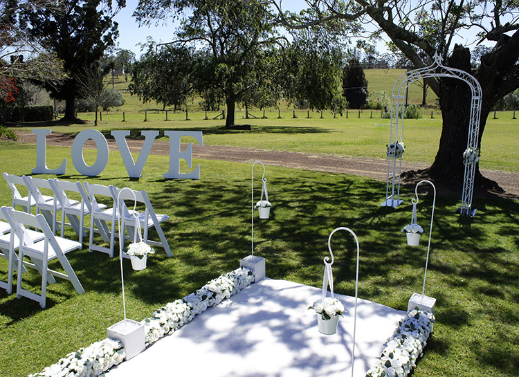 Garden Wedding Ceremony including Love Sign